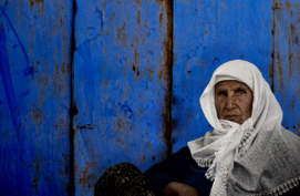 old-woman-and-blue-wall